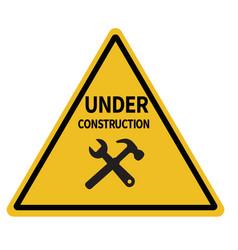 under construction triangular warning sign on vector image