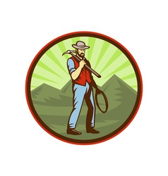 Miner carrying pick axe with mountains vector