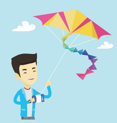 young man flying kite vector image