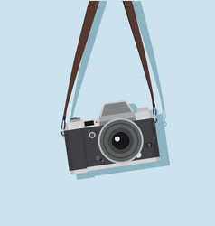 Hanging vintage camera in a flat style vector