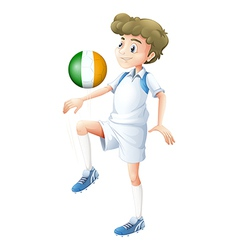 A football player using the ball with the flag of vector image