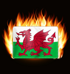 Concept wales flag on fire background country vector