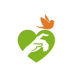 hand and bird on heart shape background vector image