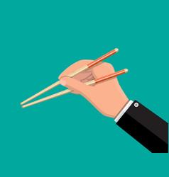 Kitchen asian chopsticks in hand vector