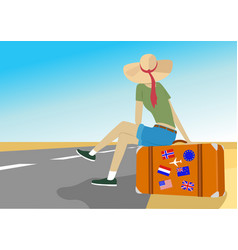 young traveler woman sits on suitcase on highway vector image