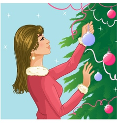 Young woman decorates a christmas tree with balls vector image vector image