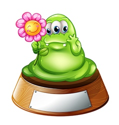 A green monster holding a flower vector image