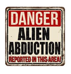 Danger alien abduction vintage rusty metal sign vector