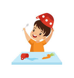 Boy dabbling with food at table cute naughty kid vector