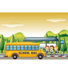 Children getting on school bus at bus stop vector