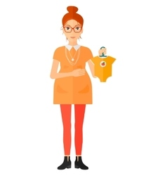 Pregnant woman with clothes for baby vector image