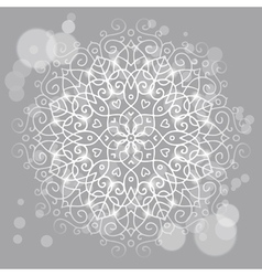 Abstract grey background with a round mandala vector image