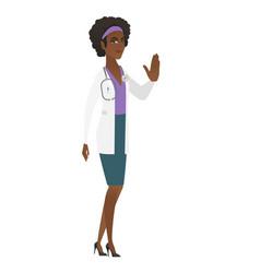 African-american doctor showing stop hand gesture vector