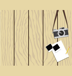 Retro camera and instant photo frames on wooden ba vector