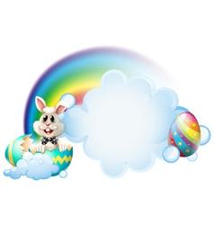 A cracked egg with a bunny near the rainbow vector image vector image