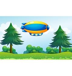 An airship near hilltop vector