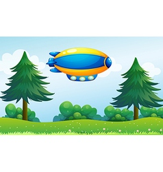An airship near the hilltop vector