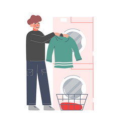 young man doing laundry at home or public vector image