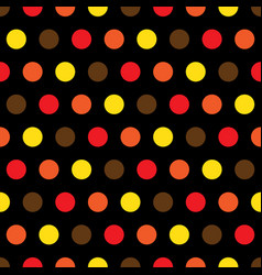 red orange yellow polka dots on black background vector image