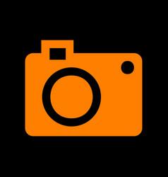 digital camera sign orange icon on black vector image