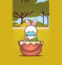 cute rabbit near basket with eggs wearing mask to vector image