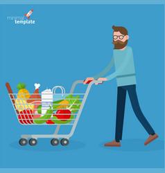 young man walking with shopping cart vector image vector image