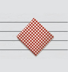 Red napkin on a wooden background plaid gingham vector