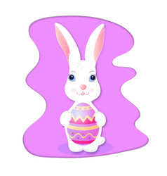 Funny rabbit holds a painted easter egg vector