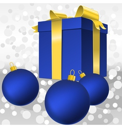 christmas blue gift box with gold ribbon and balls vector image vector image