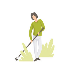 man caring for plants with hoe in the garden vector image
