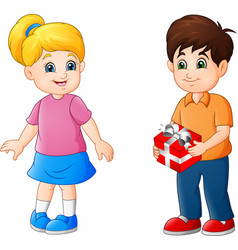 cute little boy giving present to a girl vector image