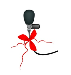 A Black Wireless Microphone with Red Ribbon vector image vector image