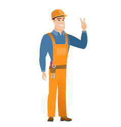 Caucasian builder showing the victory gesture vector