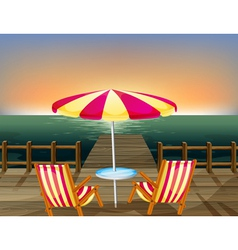 A wooden bridge with an umbrella and chairs vector image