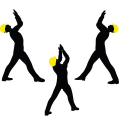 Worker silhouette with yellow protective headgear vector