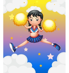 A cheerleader with yellow pompoms vector