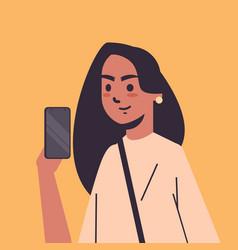 Indian woman taking selfie photo on smartphone vector