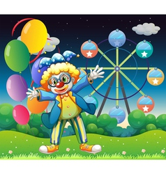 A clown with balloons near the ferris wheel vector