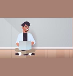 indian man sitting lotus pose using laptop guy vector image