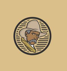 American cowboy in a hat logo or emblem vector