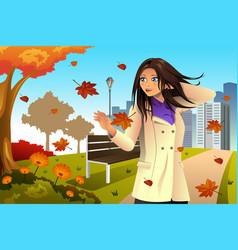 Autumn girl walking in the park vector