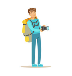Happy young man standing with backpack and holding vector