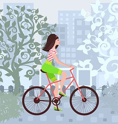 Beautiful girl is riding on a bicycle in a city vector image