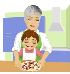 Grandmother with her grandson preparing pizza vector image vector image