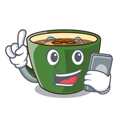 With phone indian masala tea in cartoon glas vector