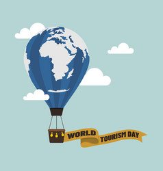 air balloon with world tourism day text on ribbon vector image
