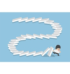 Businessman escaping from falling dominos vector image