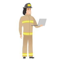 Firefighter using laptop vector