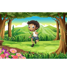 An energetic young boy in the middle of the forest vector image vector image