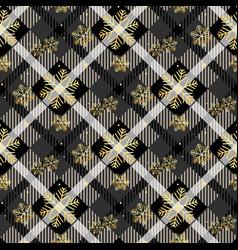 golden snowflakes seamless on dark tartan fabric vector image
